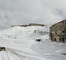 BMW R75 on top of the Tende Pass in winter by Frank Kletschkus