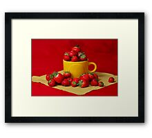 Strawberries in a sunny cup Framed Print