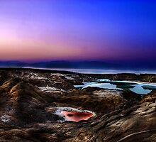 sink holes on the shore of the Dead Sea, Israel by PhotoStock-Isra
