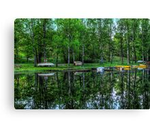 Boats in the stream Canvas Print
