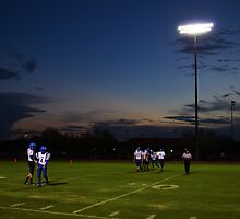 Football Players and Sunset by Charity Holm