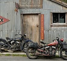 Indian Chout and Chief Bobber at the old Okains Bay Garage by Frank Kletschkus