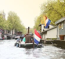 View of Amsterdam canal from boat by sceneryphotosto