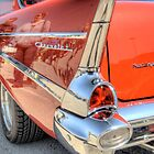 Rear End Of a Red Classic Car by David Shayani
