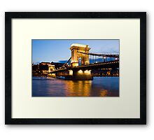 The Chain Bridge in Budapest lit by the street lights Framed Print