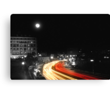 City and the moon Canvas Print