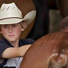 A young Cowboy among the Horses by Clare Colins