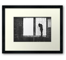 Silhouette Against White Boards Framed Print