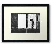 Silhouette Against White Boards Framed Print