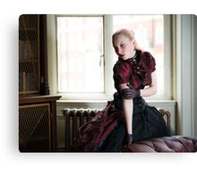 Victorian woman in library Canvas Print