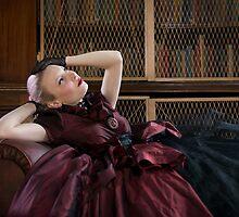 Victorian woman in library by Nando MacHado