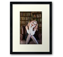 Lost in though in library Framed Print