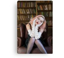 Lost in though in library Canvas Print