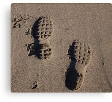 Footprints on the beach Canvas Print