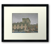 Houses reflected in the river Framed Print