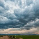 Storm Clouds on The Road Home by Gregory J Summers