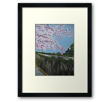 Cherry blossom falling - with river - realistic meets whimsical Framed Print