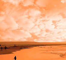 a lone child in silhouette on beach by morrbyte
