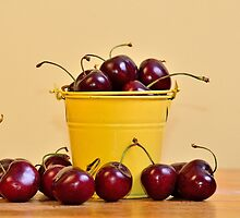 Red Cherries in a yellow bucket by 7horses