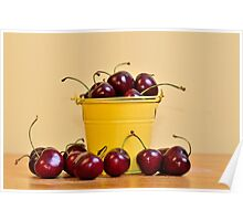Red Cherries in a yellow bucket Poster