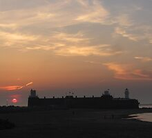 SUNSET OVER NEW BRIGHTON FORT AND LIGHTHOUSE by gothgirl