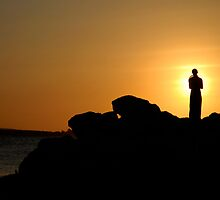 Woman on rocks at sunset by Michiel Meyboom