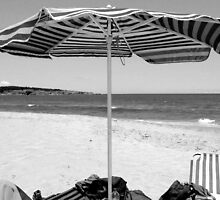 Under the umbrella at the beach Chania, Crete, Greece by Susan Wellington