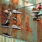 Urban Art. Shoes in Greenpoint, Brooklyn, New York by Mon Zamora