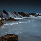 Wet Rocks, Stormy Sky by bazcelt