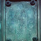 Salerno Saint Bronze on door 198403200008 by Fred Mitchell