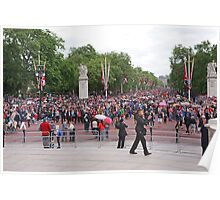 Crowds walk down the mall after Trooping The Colour to watch the Royals on the balcony Poster