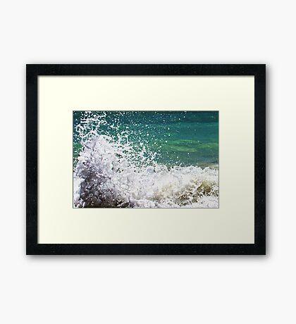 Waves crashing on the rocks close Framed Print