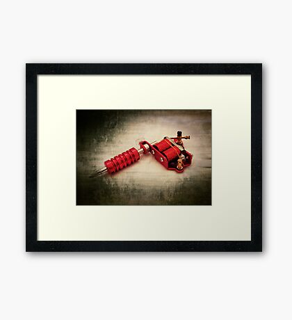 Tattoo gun Framed Print