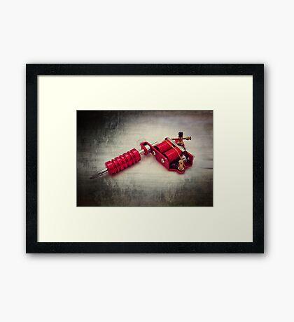 Tattoo gun Framed Print
