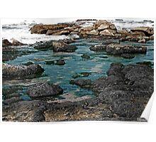 Black Rocks on Blue Water Poster