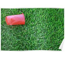 Red Plastic Cup on a Green Grass Poster