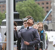 An Air cadet raising the flag at City Hall by Keith Larby