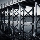 Reflection of a pier by Claudia Sims