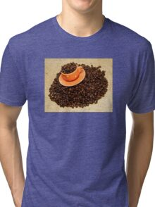 Coffee cup on coffee beans Tri-blend T-Shirt