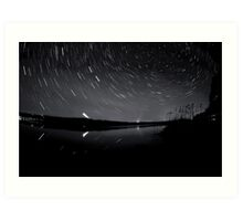 Star trails over the lake Art Print