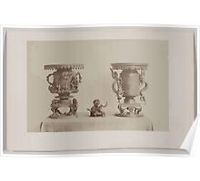 Tall metal ornate plant stands and figurine all with dragon motif on a table 001 Poster