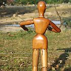 Gustaf the Wooden Man - Feeling a Little Parched by Shari Rucker