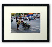 Crossing the road in Vietnam Framed Print