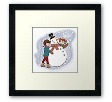 two happy girls building a snowman. Vector illustration Framed Print