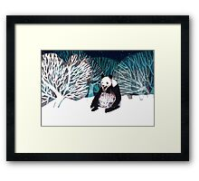 Panda bear in the snow Framed Print