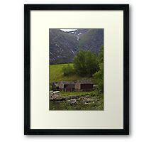Wooden shacks at the waters edge Framed Print
