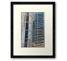 Reflection in skyscraper window Framed Print