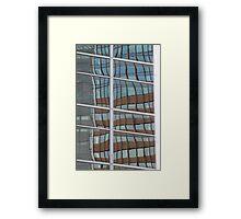 Reflection in skyscraper windows Framed Print