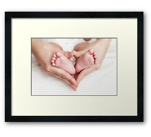 Newborn baby in the mother hands Framed Print