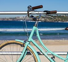 A bicycle and the ocean by Justine Gordon